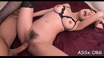 slutty asian stuffs a lady finger into her.