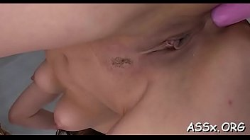 horny oriental stuffs a lady finger into her.