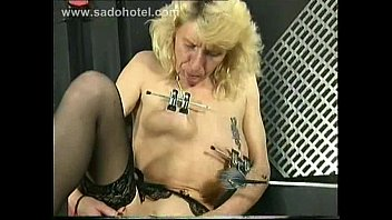 german slave with metal clamps on her pussy.