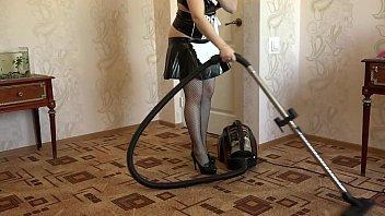 a maid vacuum cleaner and masturbates.