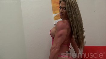 sexy female bodybuilder shows off perfect.