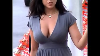 busty candid american girl walking down the street,.