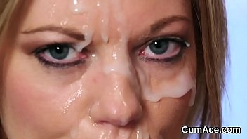 flirty stunner gets cum load on her face.