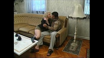 sexy blonde in black boots seduces a distracted.