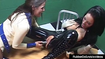 sexy latex rubber doll worshiped by slave cadet.