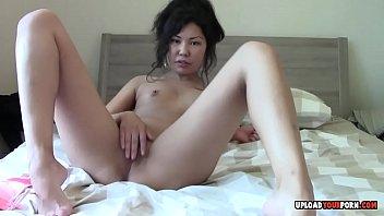 asian beauty fingering her cunt