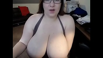 hot babe with huge tits masturbating with dildo.