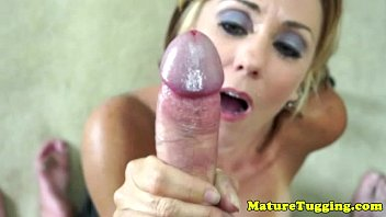 old mature blonde is giving handjob