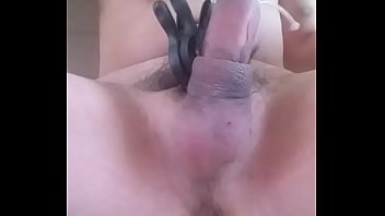 cbt ballbusting the scrotum which is hold by clamps