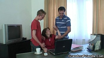 old bitch takes two cocks in.