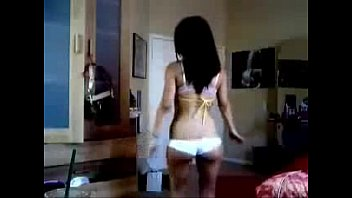 sexy latina chick with a hot body dancing.