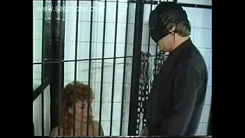 slave with nice tits sitting in a jail.