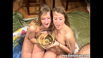 twins enjoy a bukkake and golden showers part.