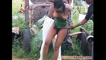 african babe ebony pussy fucks outdoor in bondage.