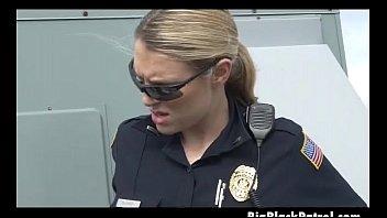 two white female cops handling black shaft on.