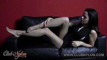 brunette tiff naylor teasing her nylon pantyhose legs.