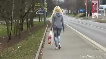 bursting to pee in public, pretty young girl.