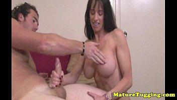busty stepmom wanking a cock dry.