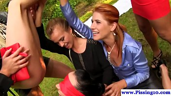 glamorous piss babes outdoors in group