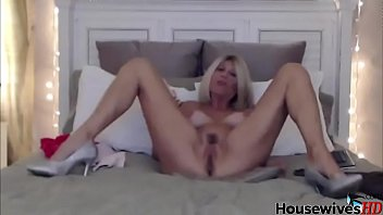 busty blonde mature solo in bed