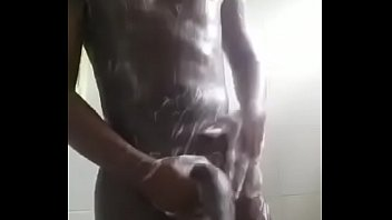 ebony guy bathing a big dick