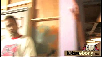 ebony babe sucking a group of horny white.