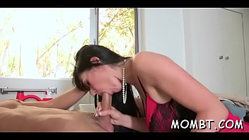 hot mum is giving hunk a lusty cock.