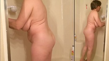 sexy naked grandma cleans the shower.