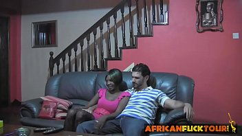 african chick talked into riding white cock on couch