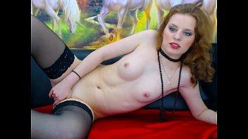 sexy young redhead teen masturbates pussy stockings on.