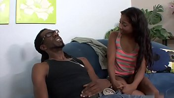 hung black stud nails young ebony on the sofa