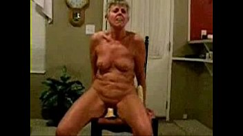 fully nude granny riding a dildo
