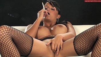 sasha cane - smoking as she plays with.