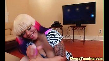 tattooed ebony babe tugging on fat.