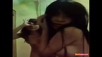 two petite asians dancing naked on.
