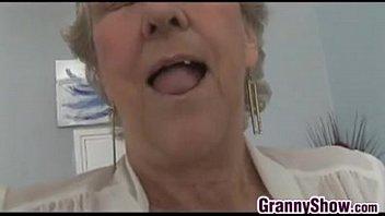 grandma teasing her pussy with panties.