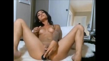 hot brunette with sexy ass playing with dildo.
