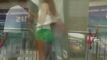 sexy brunette girl in green mini.