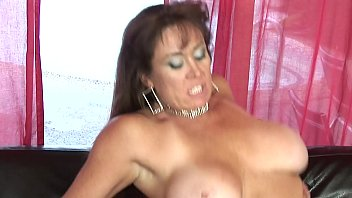 milf with huge boobs sucks cock on her.