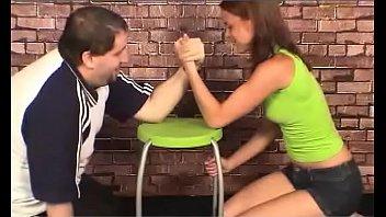 model lifts girl in green