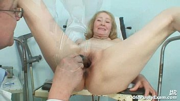 gyno doctor speculum examines old mature.