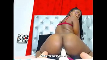 busty ebony babe putting her dildo in her ass