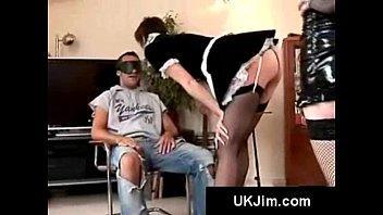 bondage loving lesbians in costumes give man a blowjob