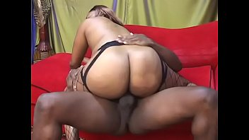 big black ass in fishnets bounces her pussy.