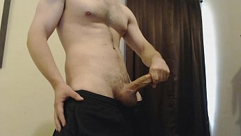 hot guy strokes big cock to.
