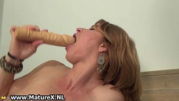 horny mature housewife is sucking