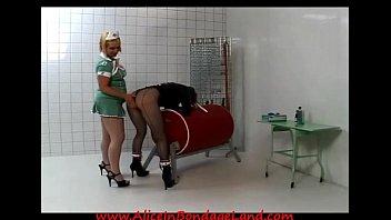 lesbian prison nurse straitjacket spanking humiliation.