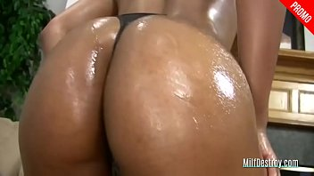 ebony cougar deep throats a cock