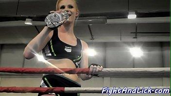 muscular women wrestling in a boxing.