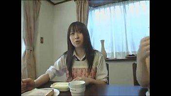 cute japanese teen gives footjob under.